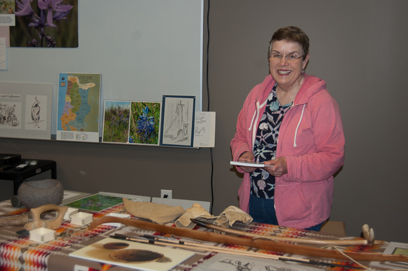 Judi Juntenen, getting her displays ready for the program.