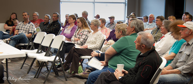 A large number of attendees listen to stories about the history of Camp Adair